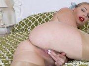 Busty blonde Danielle Maye wanking on bed in sheer nude glossy RHT nylons