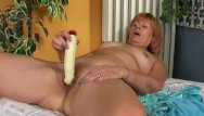 Giving pain to a womans pussy Redheaded granny gives hairy pussy a treat