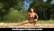 Fitness instructor nude - Sexy redhead enjoys nude fitness at the beach