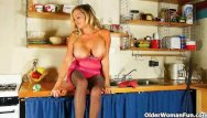 Navy pantyhose - Mom is cleaning the kitchen in pantyhose