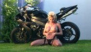 Vintage motorcycle throttle - Busty blonde teases on a motorcycle in nylon