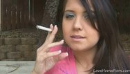 Teen girl cigarette Holding a cigarette and teasing her friend