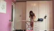Naked girl ironing Ironing the kinky clothes while completely naked