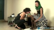 Putting on pantyhose and shoes Lesbians in a shoe store