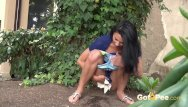 When dogs pee dark yellow Public pissing - cute dark haired teen squats to pee in a garden