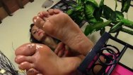 Sore bottom from diarreah - Hot babe takes off her stockings and puts oil on her sore feet