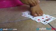 Free erotic love cards Blonde uses feet in pantyhose to play cards