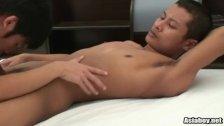Horny looking Asian boy sucking penis