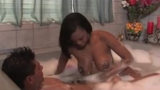 Ebony beauty gives oil massage