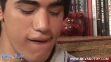 Very cute boy strokes his cock before using his sex toy