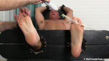 Mature Sebastian tickled with feathers