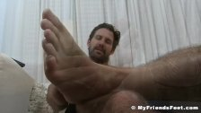 Muscular Jet caresses his handsome feet passionately