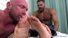 Hairy hunk Ricky feeds toes to naughty bald wanker