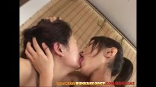 Two Japanese Lesbian babes kiss in the Spa