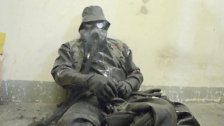rubber Nazi-Skin smoking in a gasmask
