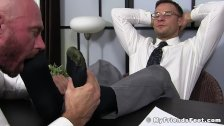 Handsome businessman feet worshiped by his new partner