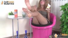 Barefoot redhead lets you give a look at her feet and under her skirt