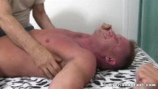 Restrained hunk enjoys tickling session with master