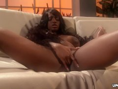 Black goddess, Jada Fire is gently masturbating on the sofa