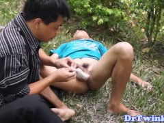 Asian MD gives outdoor enema to twink