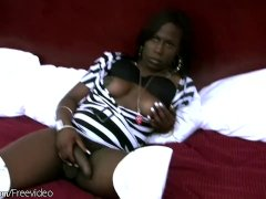 Ebony shemale exposes her uncut black shecock and big boobs