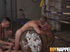 Twink gives blowjob after being punished by BDSM master