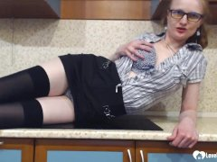 Stepmom in stockings uses a black sex toy