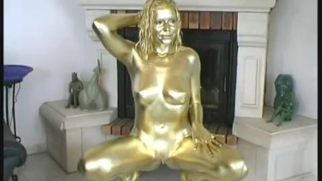 busty girl body painted in gold