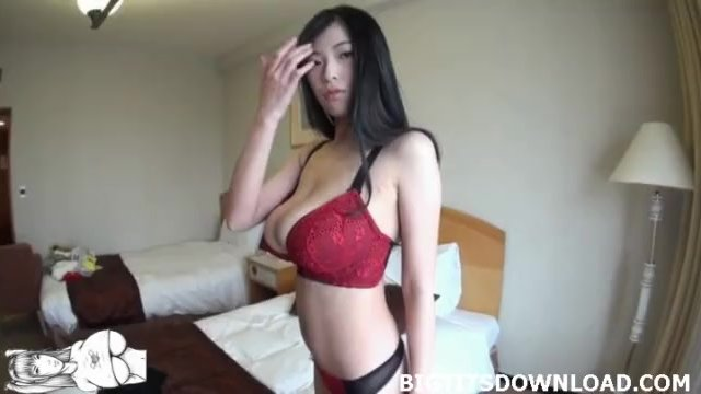 Big breasted asian posing in lingerie