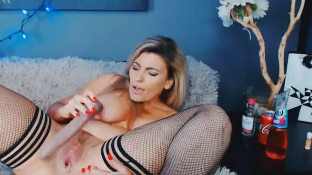 Blonde with Pierced Tits Fucks Her Pussy