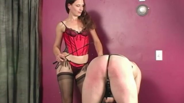 Mistress punishing male slave with her crop