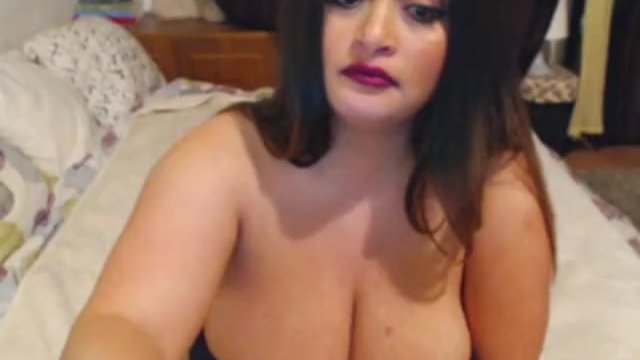 Latina with gigantic tits and huge nipples posing on webcam