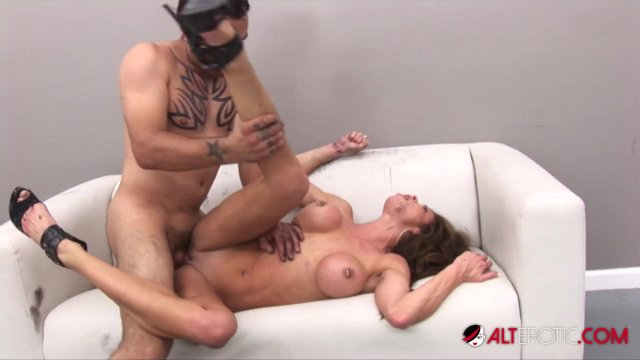 Busty brunette Hunter Bryce squirts then gets tattooed
