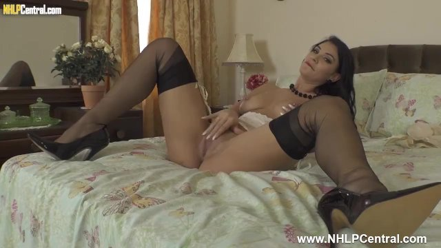 Hot babe Roxy Mendez strips off panties and wanks in black nylons and heels