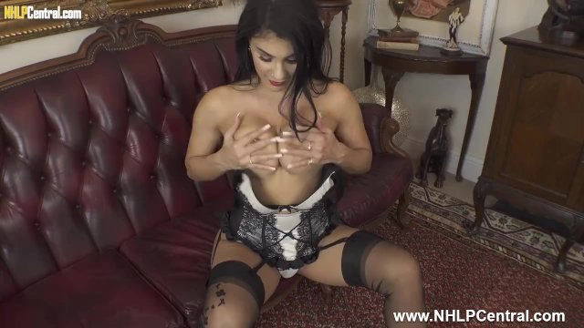Busty brunette Roxy Mendez toys pussy in sexy panties nylons and high heels