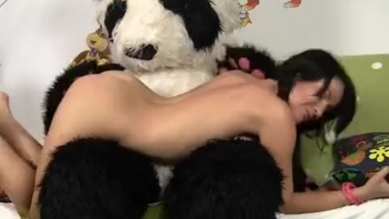 Sexy chick fucks with big plush bear