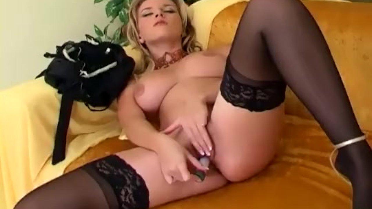 Pretty blonde fingering in stockings