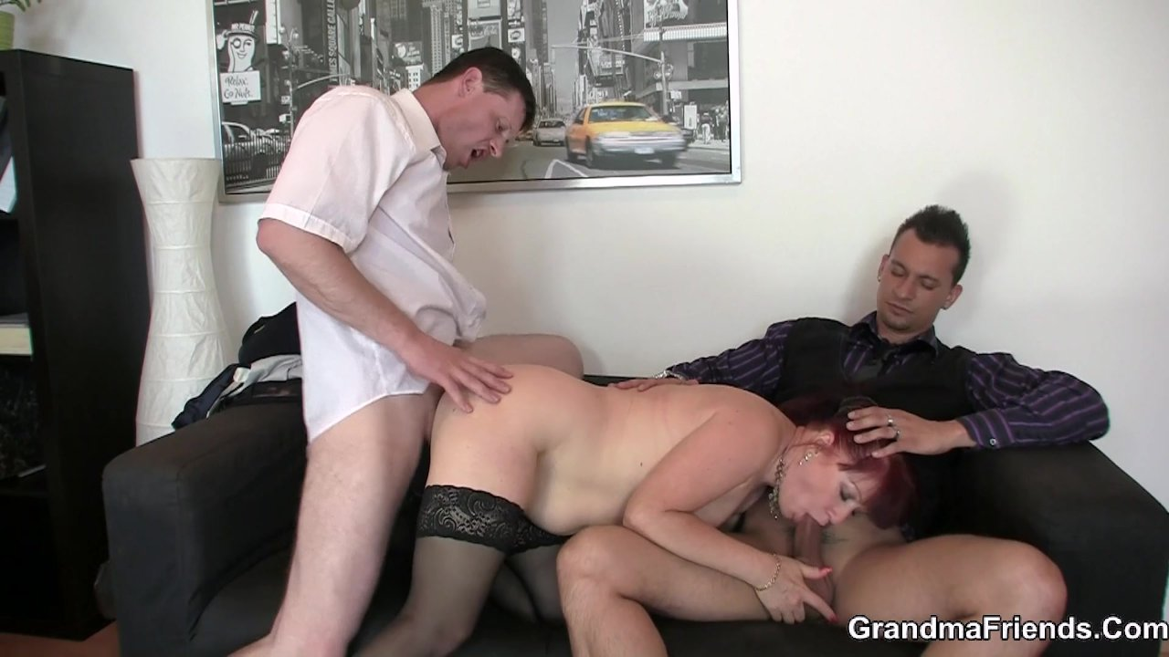 Business woman spreads her old pussy for two