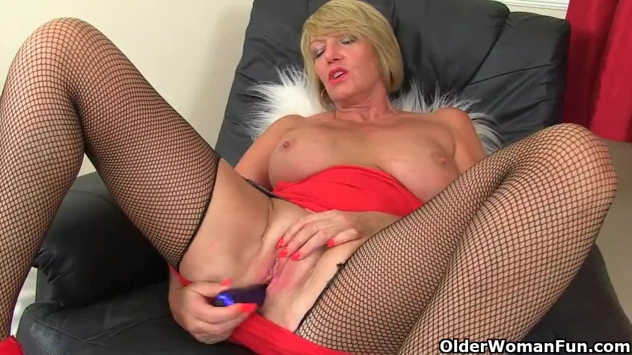 British milf Amy gets turned on in fishnets