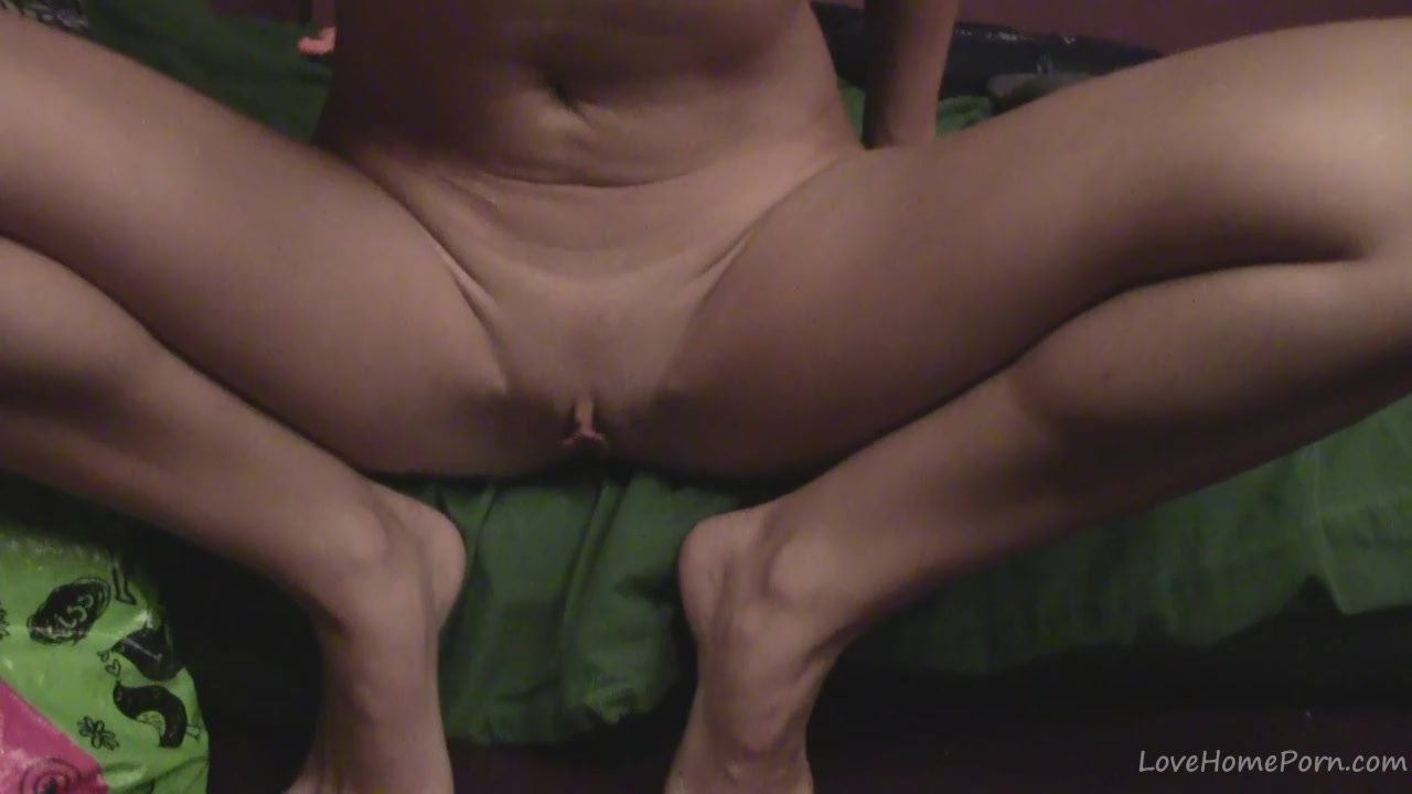 Spreading legs and fingering a pussy