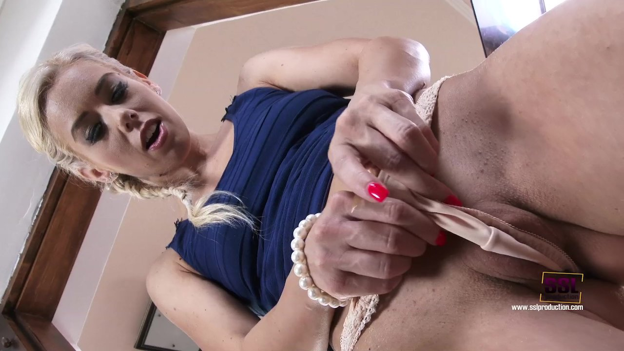 Classic blonde teeasing by the door before fingering her wet pussy