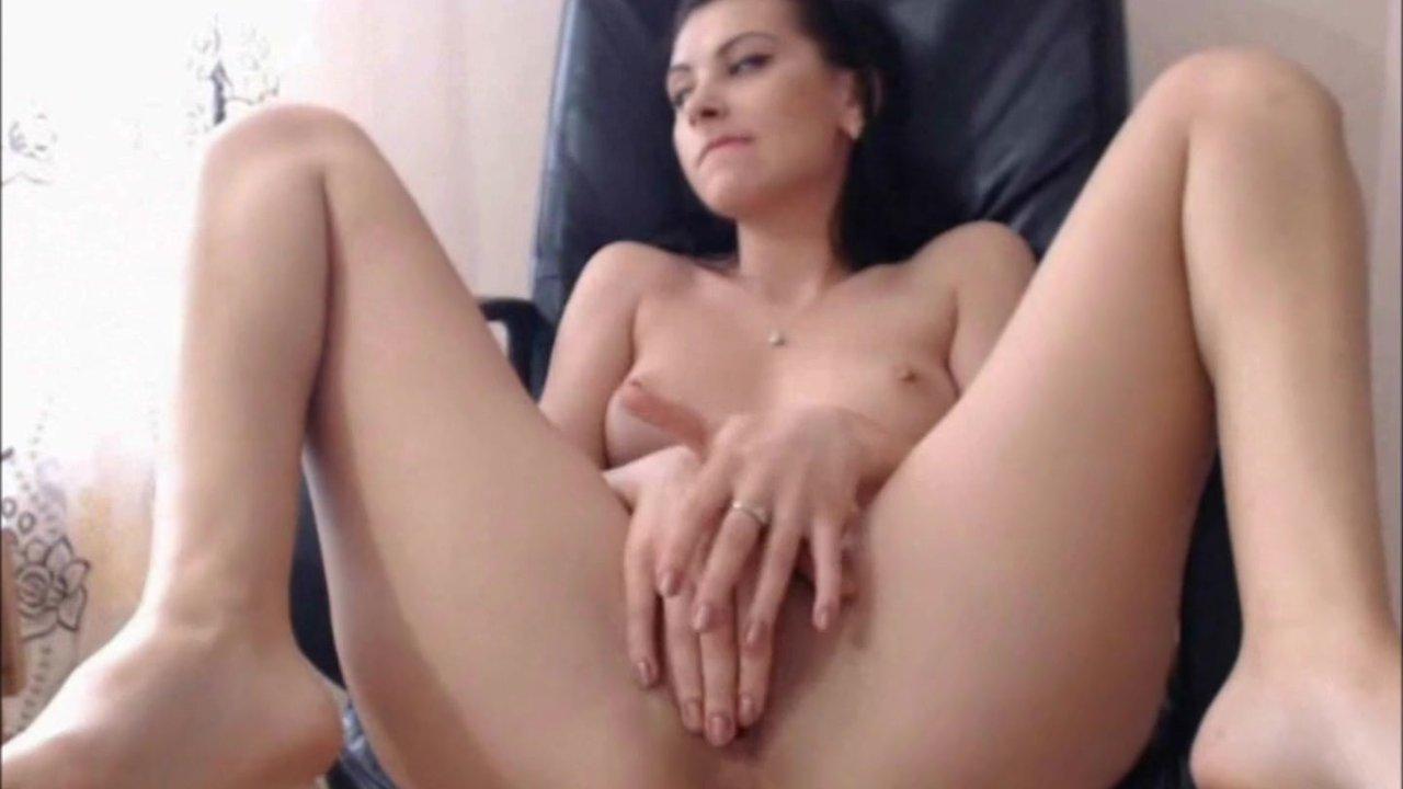 Lovely amateur brunette fingering her cunt