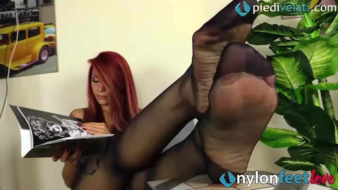 Redhead in reinforced toes pantyhose teases you