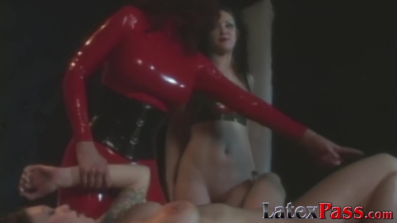 Mistress Radia dominates two submissive babes with toys