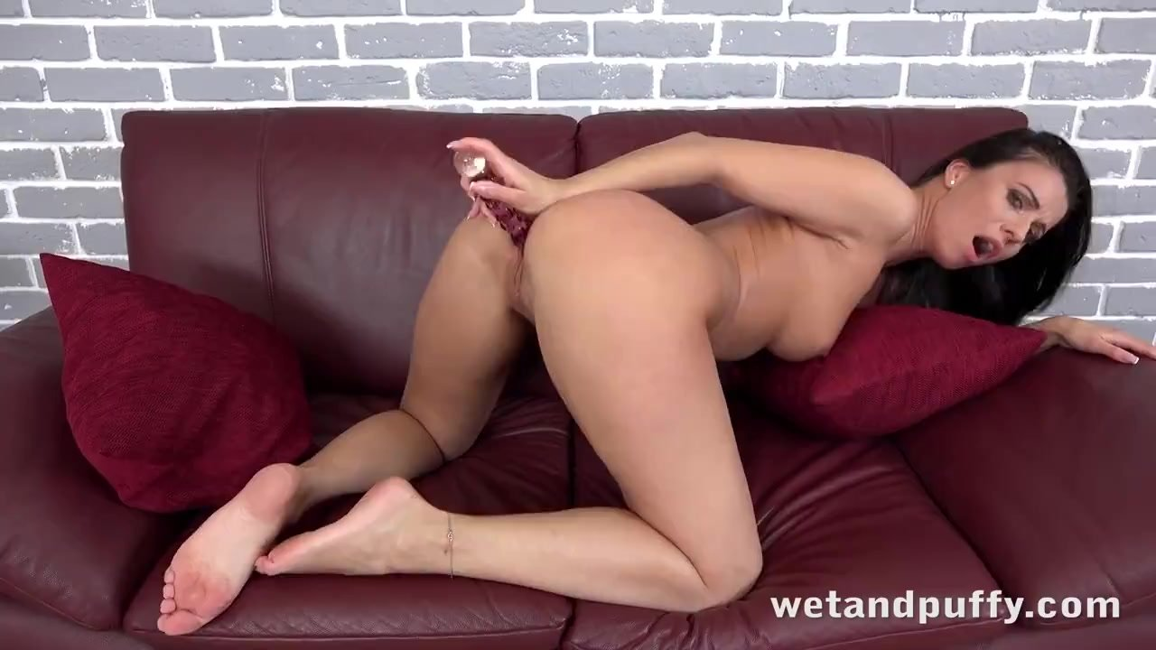 Sexy Brunette Pleasures Herself With Big Glass Dildo