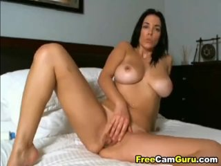 Busty babe fingering her wet pussy