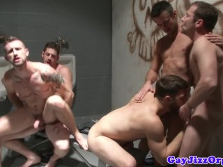 Muscular hunks enjoying fuck at the dark room