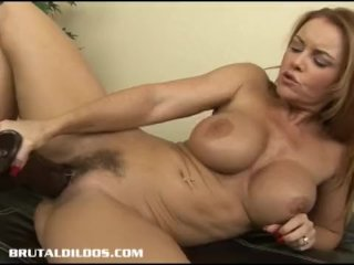 Milf Janet taking every foot of a thick dildo