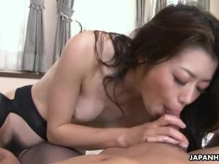 Japanese husband watches his wife blow a youn