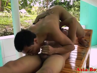Asian twinks fuck and suck outdoors